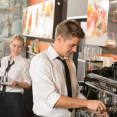 Young waiter and waitress working in bar — Stok fotoğraf