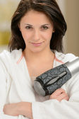 Confident girl posing with blow dryer — Stock fotografie