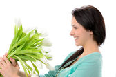 Elated young woman with bouquet of flowers — Stock Photo