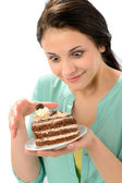 Tempting sweet cake and young hungry woman — Stock Photo
