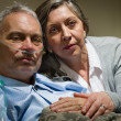 Anxious senior wife holding her sick husband - ストック写真