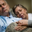 Old couple sleeping together man nasal cannula - Stock Photo