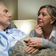 Senior patient at hospital with worried wife - Foto Stock