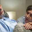 Anxious old woman taking care of husband — Stock Photo