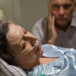 Dying woman in bed with caring man — Stock Photo