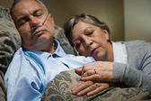Old couple sleeping together man nasal cannula — Stock Photo