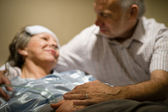 Old woman in pain lying bed — Stock Photo