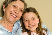 Portrait of smiling grandmother and granddaughter — Stock Photo