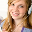 Portrait of a teenage girl listening music - Stock Photo