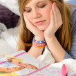 Lying depressed girl with broken heart - Stock Photo