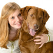 Young smiling girl with her playful dog — Stock Photo #25552201