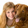 Stock Photo: Cute young girl holding a dog