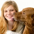 Portrait of girl snuggling with her dog — Stock Photo