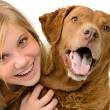 Adolescent girl embracing her golden retriever — Photo