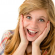 Happy girl expressing her joyful emotions - Stock Photo
