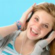 Cheerful girl listening to music with headphones — Stok fotoğraf