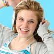 Stock Photo: Carefree teenage girl dancing to music