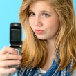 Young girl taking picture of herself - Stock Photo