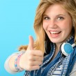 Cheerful teenage girl showing thumbs up — Stock Photo