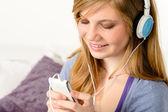 Fresh adolescent girl listening to music — Stock Photo