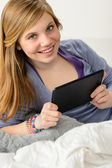 Happy young girl using digital tablet — Stock Photo