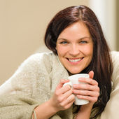 Portrait of joyful woman drinking hot beverage — Stok fotoğraf