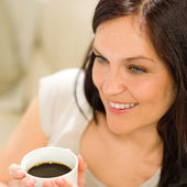 Close up woman holding cup of coffee — Stock Photo