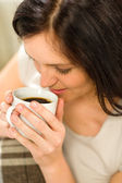 Relaxing woman drinking hot beverage for enjoyment — Stock Photo