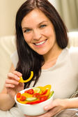 Portrait of woman eating healthy salad — Stock Photo