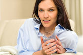 Portrait of woman with glass of water — Stock Photo