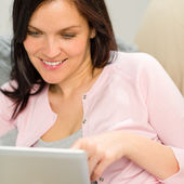 Portrait of woman using laptop at home — Stock Photo