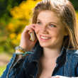 Stock Photo: Pretty young girl talking on the phone