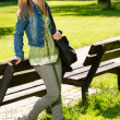 Stock Photo: Young smiling girl relaxing in the park