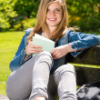 Young female student studying in the park — Foto Stock