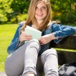 Young female student studying in the park — Stok fotoğraf