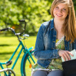 Nice student girl sitting in the park — Stock Photo