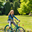 Stock Photo: Girl enjoying summer break riding bicycle