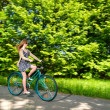 Young womcycling during sunny summertime — Stock Photo #26231273