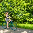 Stock Photo: Young womcycling during sunny summertime