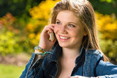 Pretty young girl talking on the phone — Stock Photo
