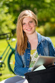 Student girl studying with tablet outside — Stock Photo