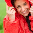 Portrait of cheerful teenager in the rain — Stock Photo