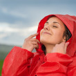 Young woman enjoying raindrops on her face — Stock Photo