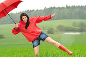 Playful happy girl in the rain — Stock Photo