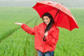 Elated smiling girl during rainy weather — Stock Photo