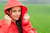 Adolescent girl in the rain in cloak — Stock Photo