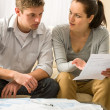 Worried couple talking about their expenses — Stockfoto #26417983