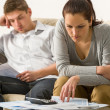Stock Photo: Annoyed couple calculating their finances