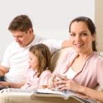 Idyllic family portrait in their home — Stock Photo