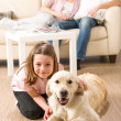 Stock Photo: A happy family of three with dog